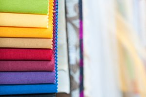 Close-up detail of multicolor fabric textile samples with copy space
